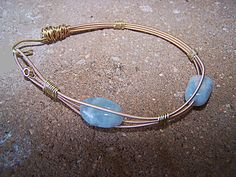 Items similar to Bronze Guitar String Side Hook Bracelet with Aquamarines on Etsy Guitar String Bracelet, String Bracelets, Hook Bracelet, Bracelet Making, Aquamarines, Vintage Bracelet, Guitar Strings, Diy Stuff, Handmade Bracelets