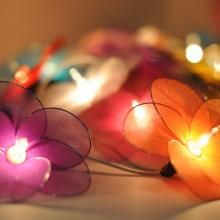 Romantic string lights are rose-sized with 20 lights per string. Lights are hand made in Thailand from 100% cotton string. | Green Bride Guide