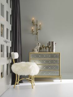 the curious swanson upholstered metal side chair and harlequin fourdrawer accent chest with mercury