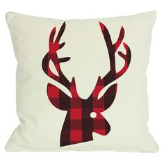 Reversible pillow with a buffalo check reindeer motif and matching back.  Product: PillowConstruction Material: ...