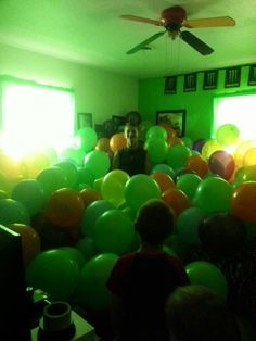 Room full of balloons for suprise party.