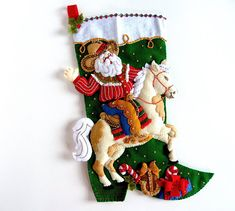 Finished Bucilla felt Christmas stocking titled Cowboy Santa. A great stocking for men or the horse rider. Ready to personalize and ship. See details below. Welcome to HometownUSA Take the tradition of hanging a stocking to a whole new level with a Bucilla stocking. Those gifts and