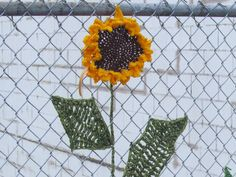 Sunflower, public art yarnbombing by nirvYARNah, 2014.