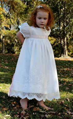 We just love this flower girl dress made for us by Jeanna Hanna. Visit our website for the pattern and materials. www.farmhousefabrics.com