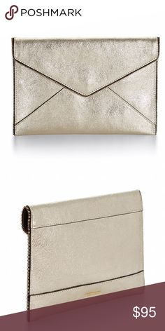 LEO CLUTCH The Leo Clutch is the perfect sidekick for a night out. It features interior credit card slots so you don't need to bring out your wallet Rebecca Minkoff Bags Clutches & Wristlets