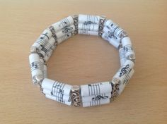 Music notes paper bead bracelet by MagdaCrafts on Etsy, £14.00