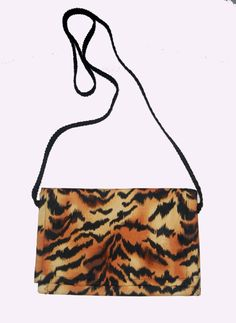 Check out this item in my Etsy shop https://www.etsy.com/listing/242093643/tiger-print-cross-body-pouch-cross-body
