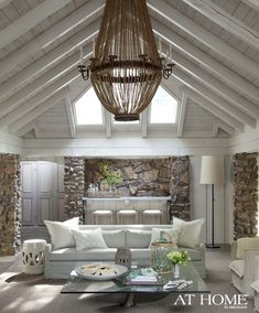 Ceiling, beams and wood walls throughout the living spaces were updated with coats of Sherwin-Williams' Agreeable Gra