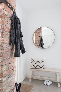 Entryway décor is very important because it's that space that speaks about your home. A trendy brick wall is a must have there!