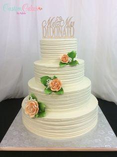 wedding cake with peach sugar roses
