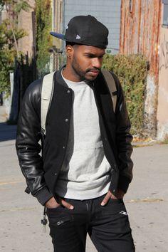 Hat: Supreme  Jacket: A.P.C.  Sweater: Club Monaco  Jeans: Hudson  Sneakers: Nike Supreme Blazers  Key chain: Killspencer