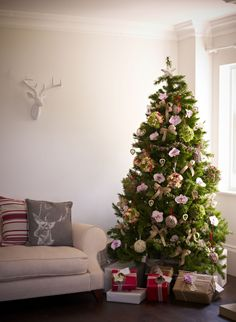 Christmas tree decorated with fresh flowers including pretty pink orchids