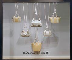Banana Republic window display beautifully hangs purses. #retail #merchandising #windowdisplay #hanging #fashion