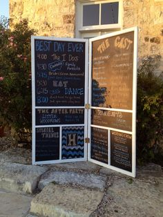 Wedding timeline on a chalkboard in blue and orange at Le San Michele in Buda, Tx