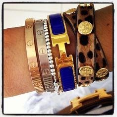 cartier, tiffany's, hermes, tory... my kind of arm party!