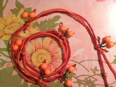 Silk cord, neon orange crystal pearls, and Walking on Sunshine mix of Swarovski CRYSTAL ELEMENTS beads.