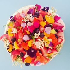 creative cake with edible flowers by by Unbirthday Bakery Sydney