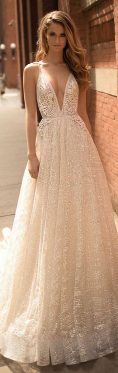 amazing deep v neck vintage a line wedding dress from Berta Planning your #VegasWedding? Make it easy and rent a tux from Downtown Tux and Gown.