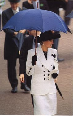 Princess Diana at Royal Ascot in June 1991 wearing a double breasted suit white suit by Catherine Walker, and black hat.