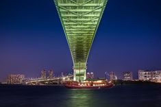 I was walking under this enormous modern bridge in Tokyo when this old ship started slowly floating by. I don't know if this is a common site or not, but it was such a cool scene! Everything was coming together, as you know this is my favorite time of the dusk to shoot. - Tokyo, Japan - Photo from #treyratcliff Trey Ratcliff at http://www.StuckInCustoms.com