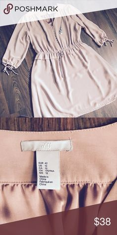 H&M Cream Button Up Dress Worn once for a Broadway show - no damage,  silk material - has an underlay for sheerness. True to size. Sits at the top of the knees for the height of 5'4   ( JEWELRY AND SHOES NOT INCLUDED)  Color: Mauve Pink/Tan Mix  Size: Size 12 (L/XL)  Smoke free home  Pet (Goldendoodle) Friendly home H&M Dresses