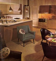 Another lovely interior -- although this looks like a studio-shot kitchen. So early 60s to have an indoor barbeque!