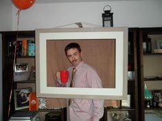 awesome... hang a frame with no back for photos!!!!