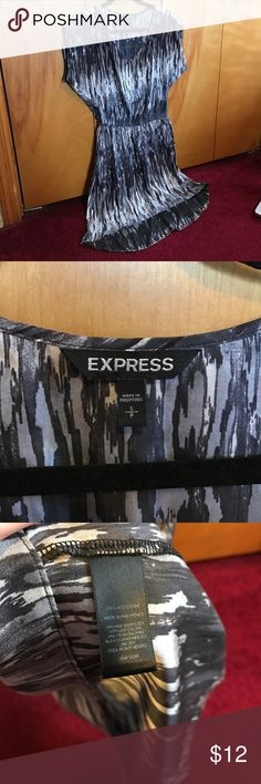 Express Dress Multi colored Express dress, size small. Sleeves of dress are cap sleeves and dress has elastic waist band as pictured. The bottom of the dress is high-low. The colors are dark Grey, light grey and purple. Worn 2-3x. Express Dresses High Low