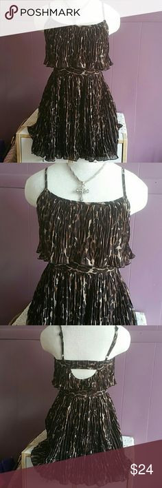 """Tunic style leopard print GUESS. Cute!! Size 1 GUESS brand, completely lined, adjystable straps, zippers on the sideelastic in back, cute tunic style. Pleated all over. Size 1. That is probably equal to an extra small. Measures as folllows...approx.....30"""" in length, 34"""" in bust from armpit to armpit. Zippers up the side. This would look so cute with black skinny jeans or cropped pants. Very good condition. No flaws. Guess Tops Tunics"""