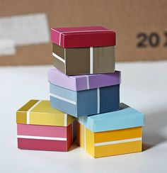Paint Chip Gift Boxes: Turn paint chips into cute gift boxes.  Source: How About Orange