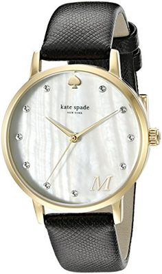 A classic #Kate Spade New York watch with a saffiano leather band. Crystals shine from the pearlized dial, and a small letter adds a subtle, personalized touch. ...