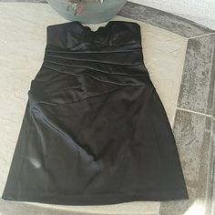 "Black Strapless Satin Dress Black satin strapless dress. Dry cleaned. Lightly padded in chest. Some stretch in top portion. 96% Polyester, 4% Spandex. No flaws. Zipper in back. Laying flat, from top of dress to bottom is approximately 28.5"" long. Hip area, across is approx 17"", chest area approx 14"". Comes from a smoke free home. Final price unless bundled. No trades, no holds, thank you. Teeze Me Dresses"