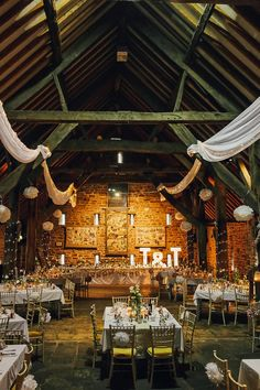 The Manorial Barn Drapes Fairy Lights Pom Poms Stylish Pastel Rustic Barn Wedding http://helenrussellphotography.co.uk/