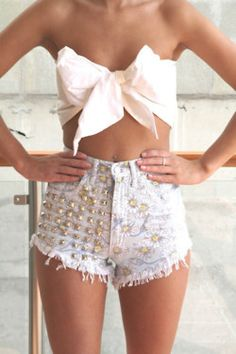 "This?? This is so ugly, I don't even know where to start. The twee boob bow...the half-studded shorts (they're floral!)...this uneven ""torn"" hem. Just burn it all."
