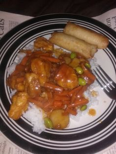Orange Chicken with rice and eggrolls (frezze food section) didnt feel like cooking that day lol