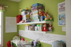 """What a labor of love this Homeschool Room was! I am seriously tickled with the results and just love how happy and cheery it is. This also functions as our Playroom, so I needed lots of storage, (although many of the bigger toys found new homes around the house). I know that we do not """"need""""…"""