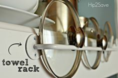 towel rack organizes pot lids