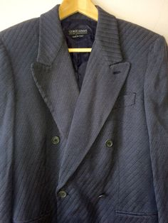 This is a rare Giorgio Armani faded navy double-breasted, point lapel jacket. The jacket is beautifully constructed with a brocade fabric,