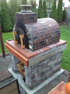 When the Moon hits your eye like a Big Pizza Pie. Well you know the rest. This Dino inspired outdoor pizza oven incorporates deeply colored brick and warm wood to make an inviting pizza oven! To see more pictures of this oven (and many more ovens) Big Pizza, Four A Pizza, Barbecue Original, Brick Bbq, Pizza Oven Outdoor, Brick Oven Outdoor, Wood Fired Pizza, Backyard, Rest