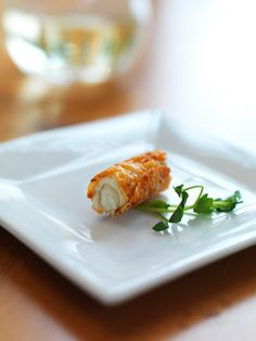Parmesan Cannoli with Boursin mousse.  Crispy cheese filled with soft cheese.  How can you go wrong with cheese squared?