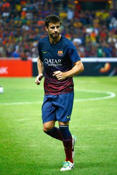Gerad Pique of Barcelona FC warms-up during the friendly match between FC Barcelona and Malaysia at Shah Alam Stadium on August 10, 2013 in Kuala Lumpur, Malaysia.  (