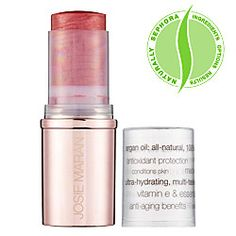 Josie Maran Argan Color Stick.. Use it as lip color, cheek color, or eye color. (Looks like a very natural flush, lasts all day!)