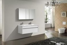 Fitto 48 in. Gloss White Wall Mount Modern Bathroom Vanity - Single Sink This floating wall-mounted bathroom vanity features one spacious drawer for storing bathroom essentials. The clean, contemporary lines are enhanced by a crisp white integrated slim Blue Bathroom Vanity, Floating Bathroom Vanities, Bathroom Vanity Lighting, Bath Vanities, Modern Bathroom, Small Bathroom, Bathrooms, Double Sink Vanity, Vanity Sink