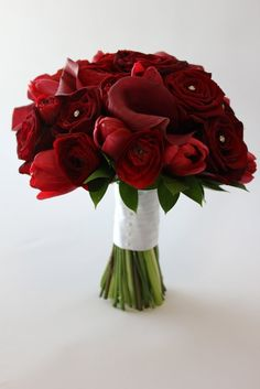red rose, calla and tulip bouquet