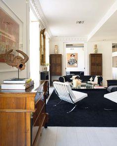 Carlos Serra Valencia home black white living room cowhide couch antique dresser Barcelona chairs
