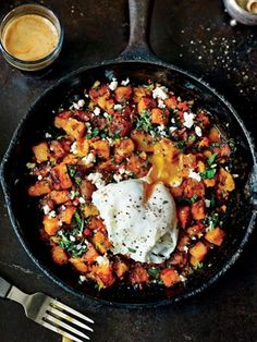 Sweet Potato Hash with Feta and Poached Eggs - Replace sunflower oil with coconut oil to make this paleo