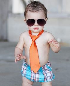 Bright and bold, every little guy will love having an orange tie in his collection! With the easy-on, velcro closure and comfy fit, your little guy will actually like dressing up!