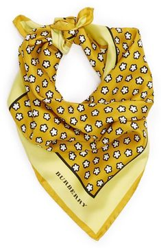 Love the floral pattern on this yellow Burberry silk scarf.