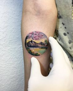 Landscape tattoo on the right inner forearm.