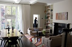 Paul Smith design on rug and possibly over fireplace. Boston Town House - Modern - Living Room - Boston - Koo de Kir